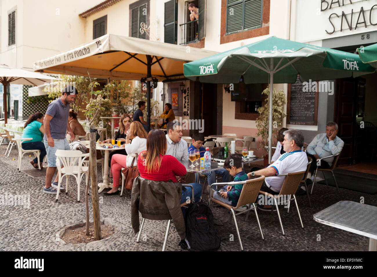 People drinking in a cafe, Funchal old town ( Zona Velha ), Madeira, Europe - Stock Image