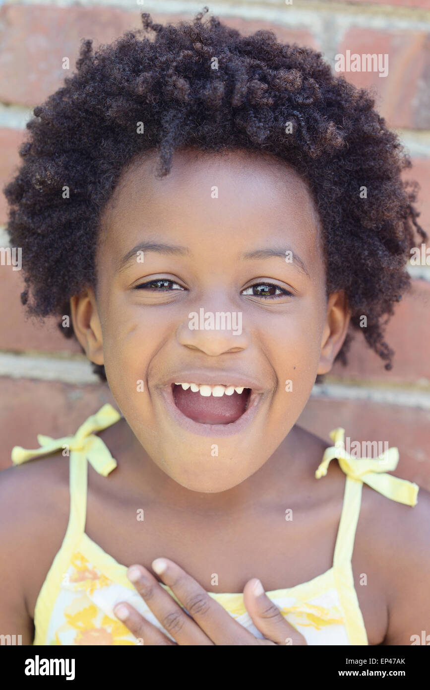 Portrait of a smiling african american girl - Stock Image