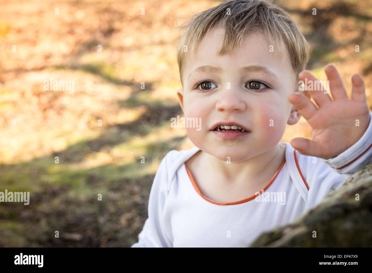 Portrait of a toddler waving - Stock Image