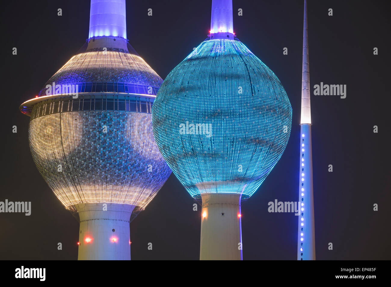 Kuwait Towers illuminated at night in Kuwait City, Kuwait. - Stock Image