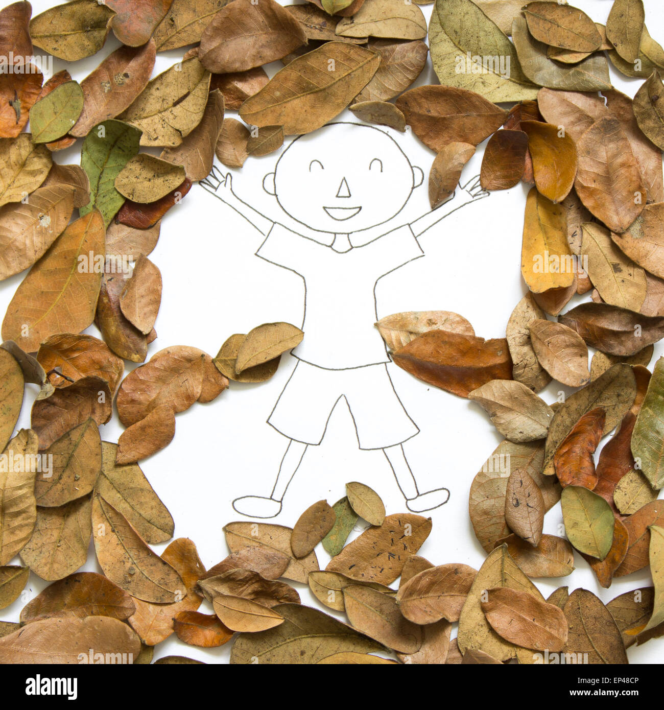 Drawing of a boy surrounded by leaves - Stock Image