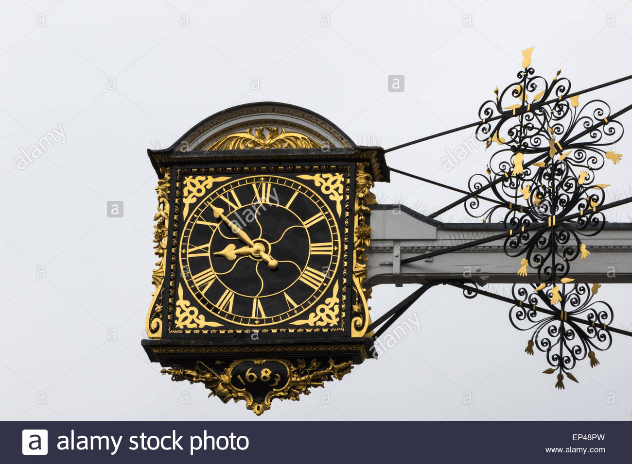 The 17th century clock which hangs above the Guildhall in the High Street of Guildford, Surrey. Made by clockmaker - Stock Image