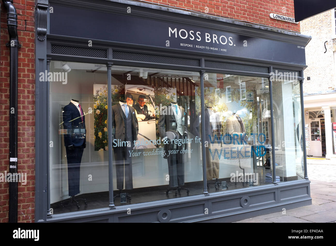 moss bros menswear retail store in the city of canterbury kent uk may 2015 - Stock Image