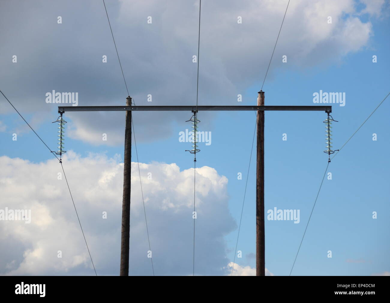 Simple electrical tower in grass field with clouds Stock Photo ...