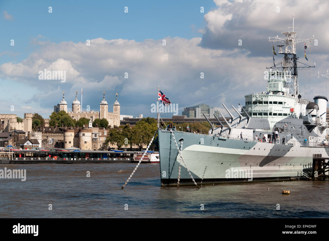 HMS Belfast and the Tower Bridge on the river Thames in London, England - Stock Image