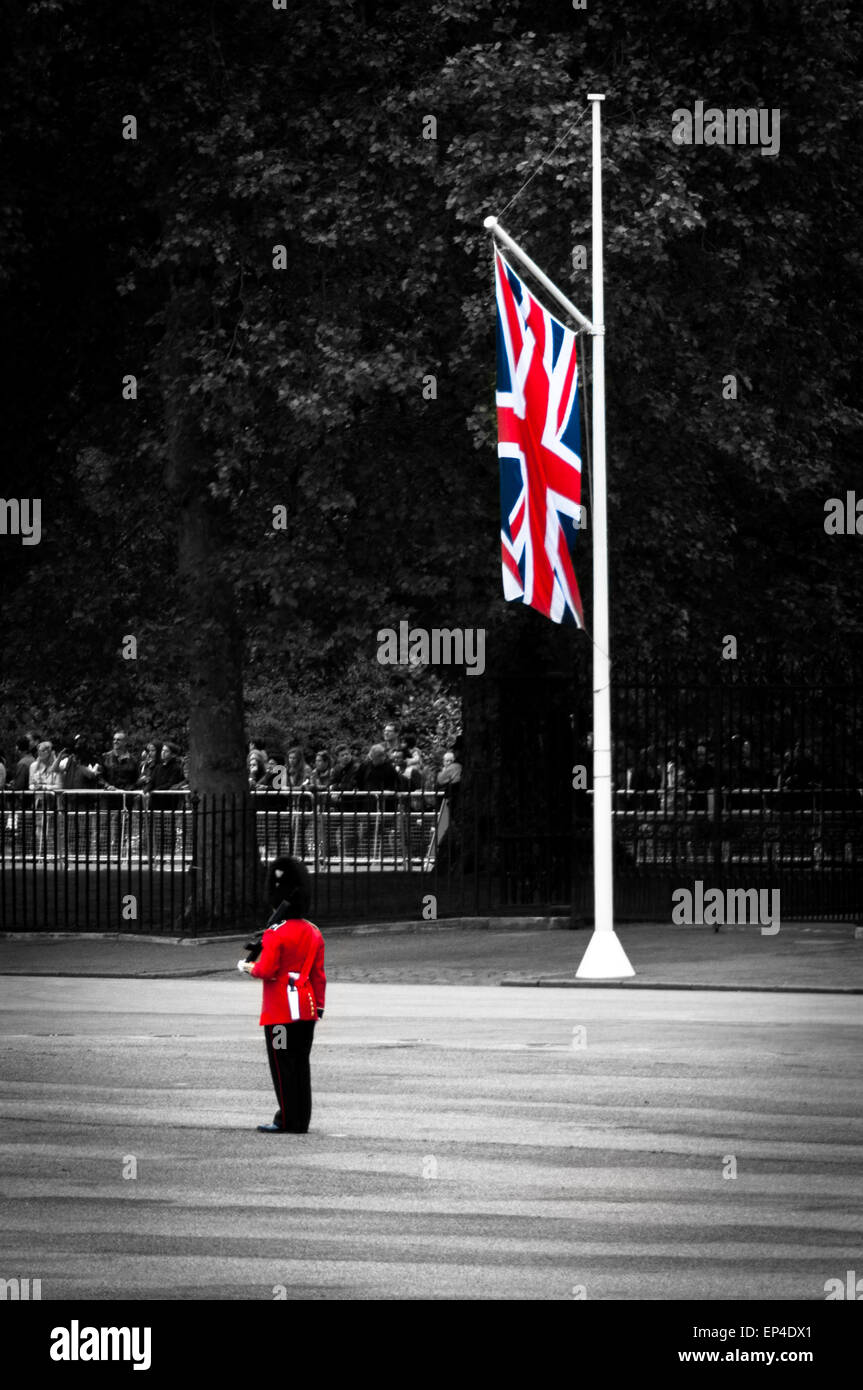 Queen's royal guard and Union Jack at the Queen's birthday parade rehearsal, London, England Stock Photo