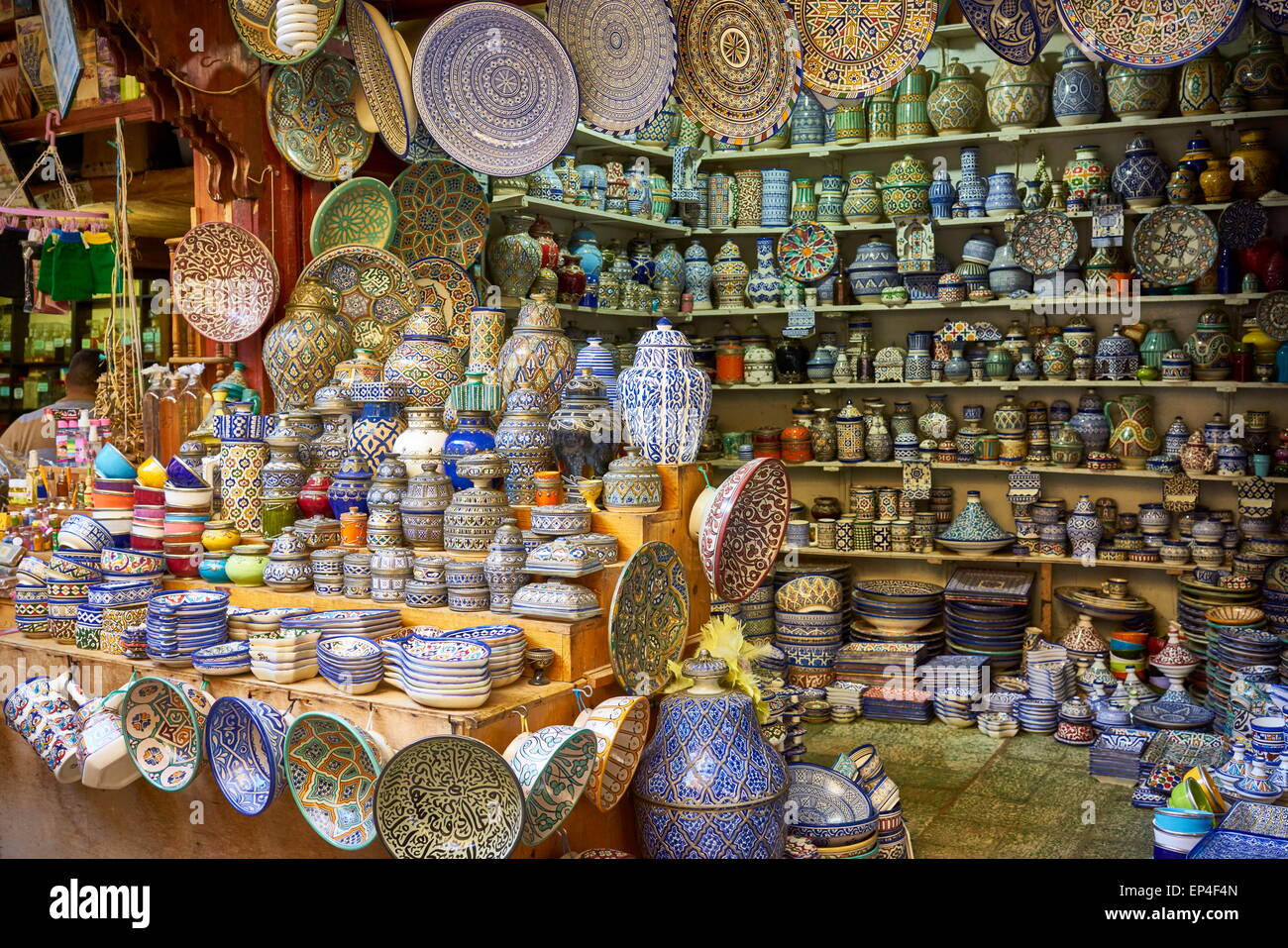 Fez, Souk in Medina, Hand painting ceramic products. Morocco - Stock Image