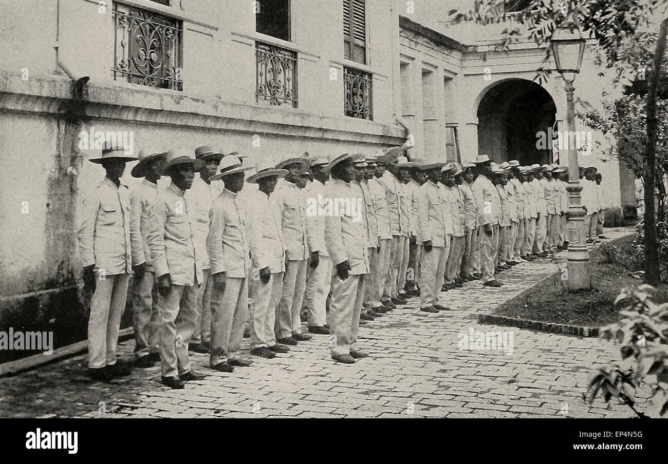 Insurgent soldiers being clothed in new uniforms on inspection during Philippine American War 1898 - 1900 - Stock Image