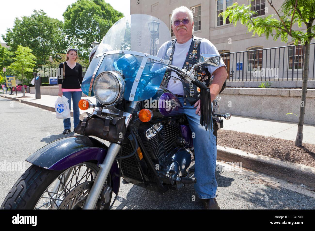 Elderly man sitting on Honda Shadow motorcycle - USA - Stock Image
