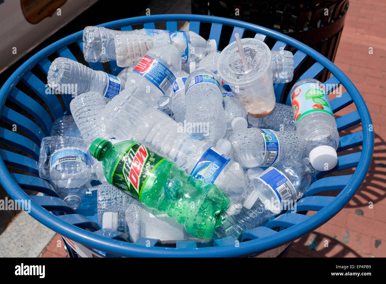 Plastic water bottles in public outdoor recycle bin - USA - Stock Image