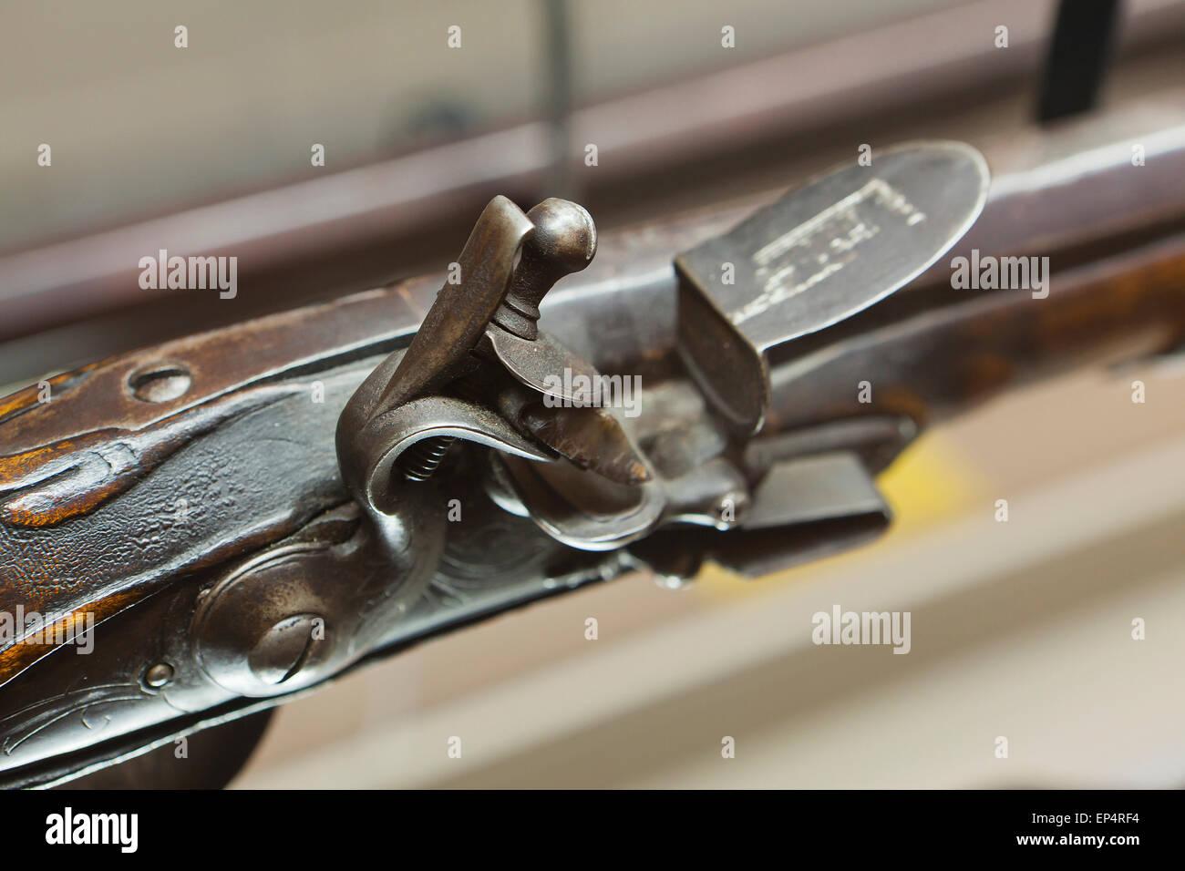 Flintlock mechanism on early 19th century American rifle (musket gun) - USA - Stock Image