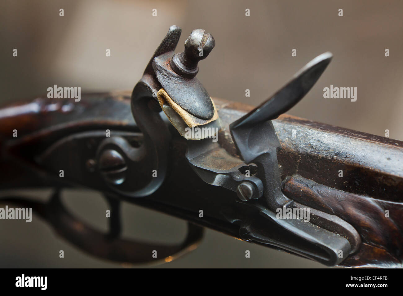 Flintlock mechanism on early 19th century American rifle