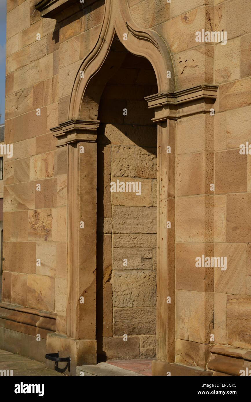 A view of the sandstone door at Dewsbury Minster - Stock Image