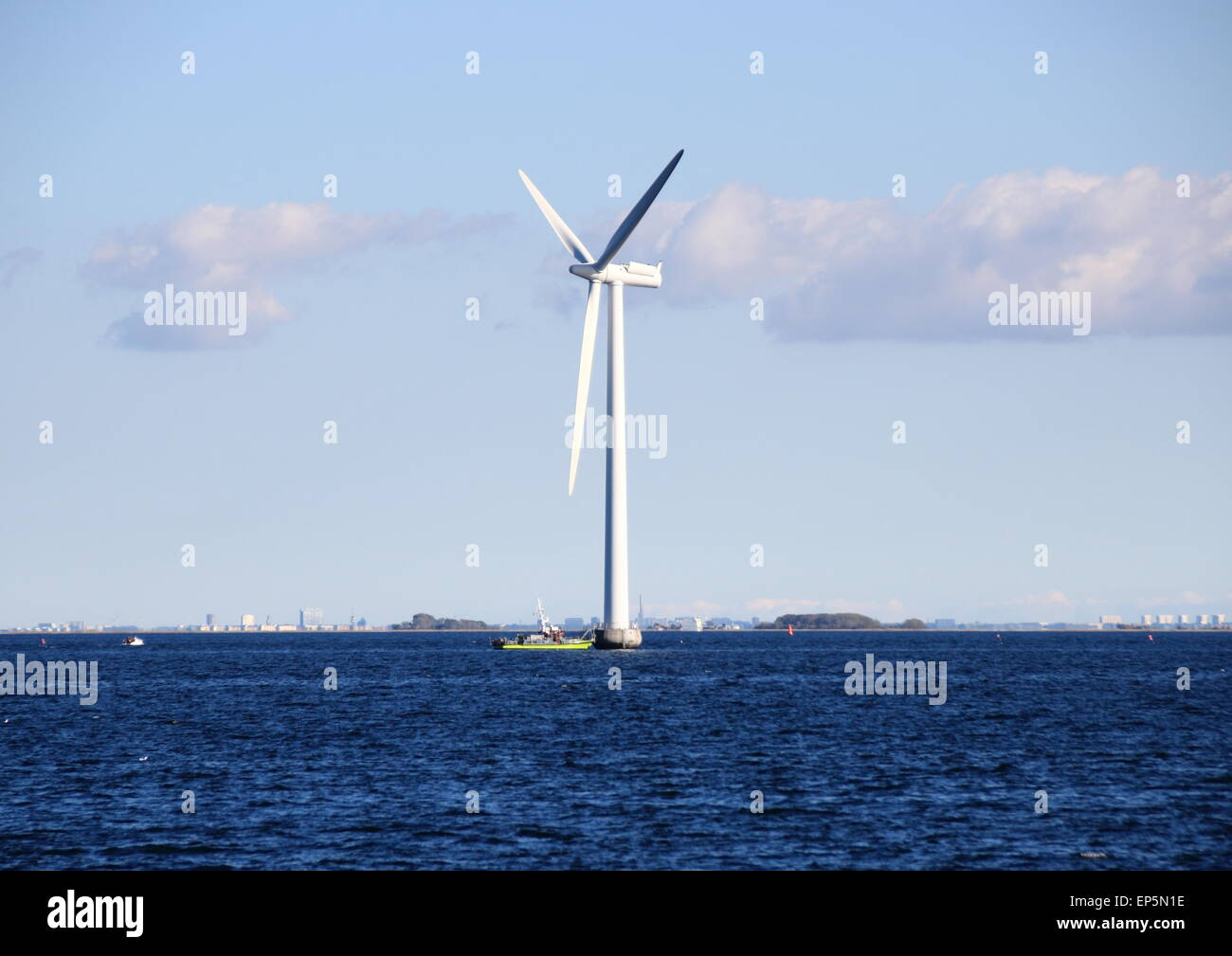 Ocean windmill in rough sea with inspection ship Stock Photo ...