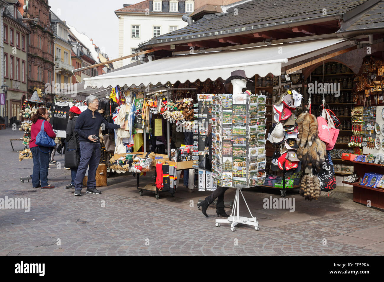 tourists shopping for souvenirs on the Marktplatz, Heidelberg, Baden-Württemberg, Germany - Stock Image