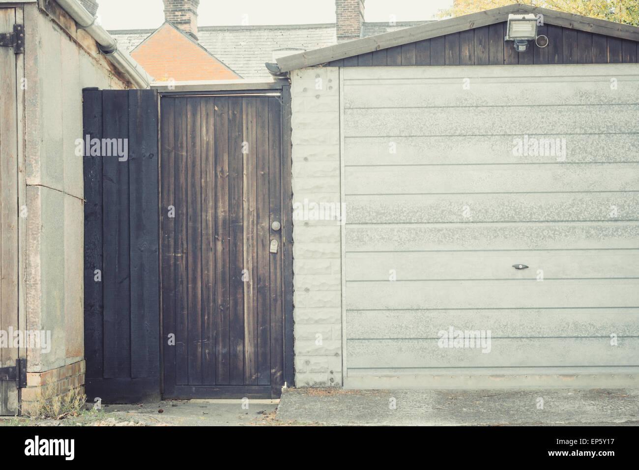 Rear Garden And Garage Door Closeup Vintage Filter Applied