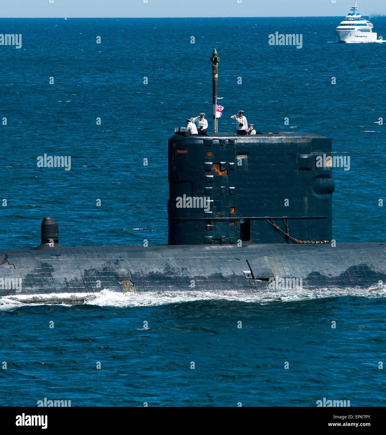 The hunter killer nuclear submarine HMS Triumph giving marks of respect - Stock Image