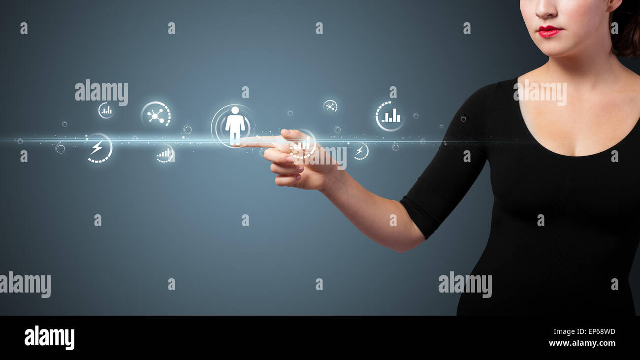Businesswoman pressing modern social type of icons - Stock Image