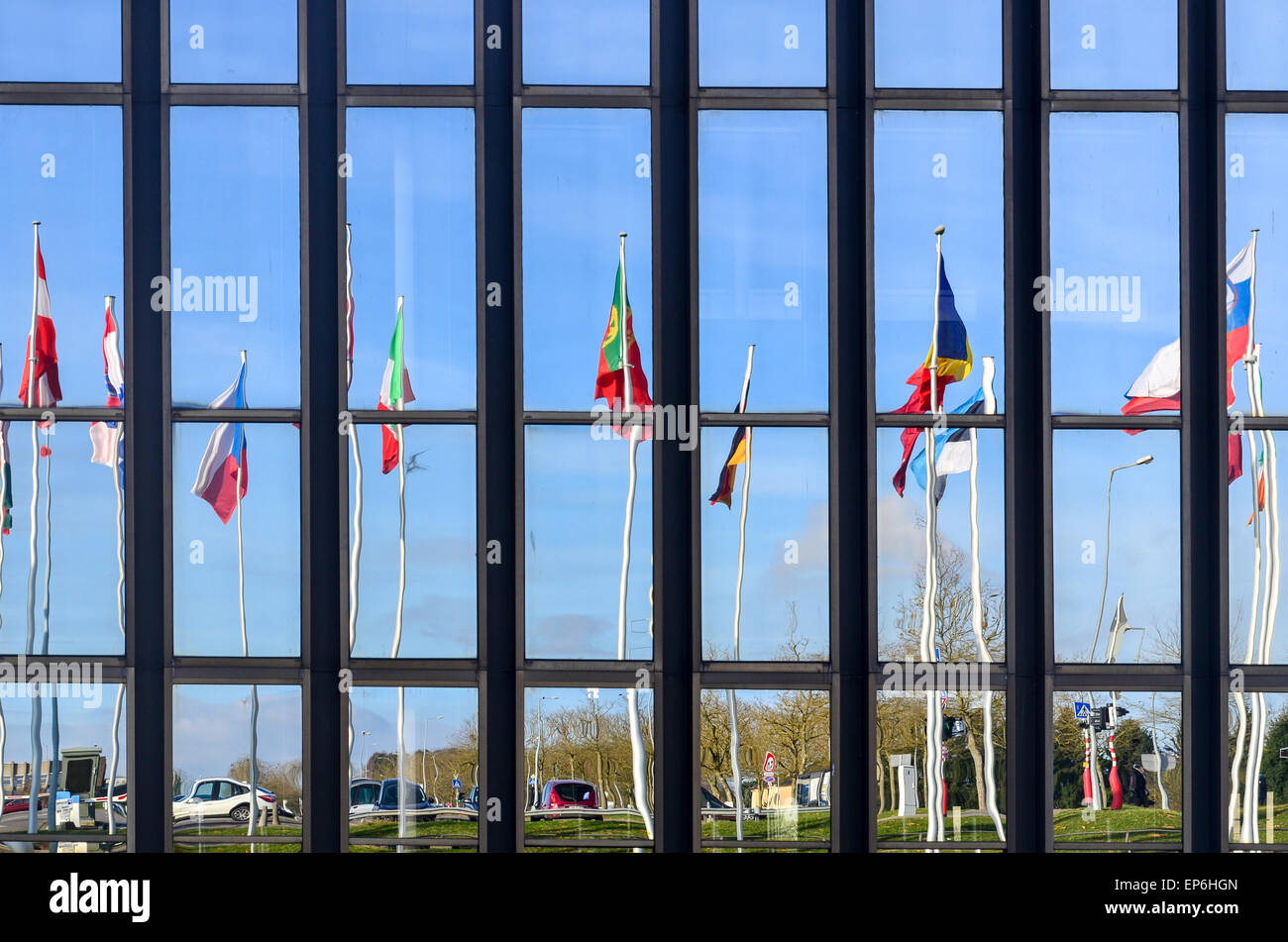 Flags of the European Union countries reflecting on the European Commission building, European Quarter, Luxembourg - Stock Image