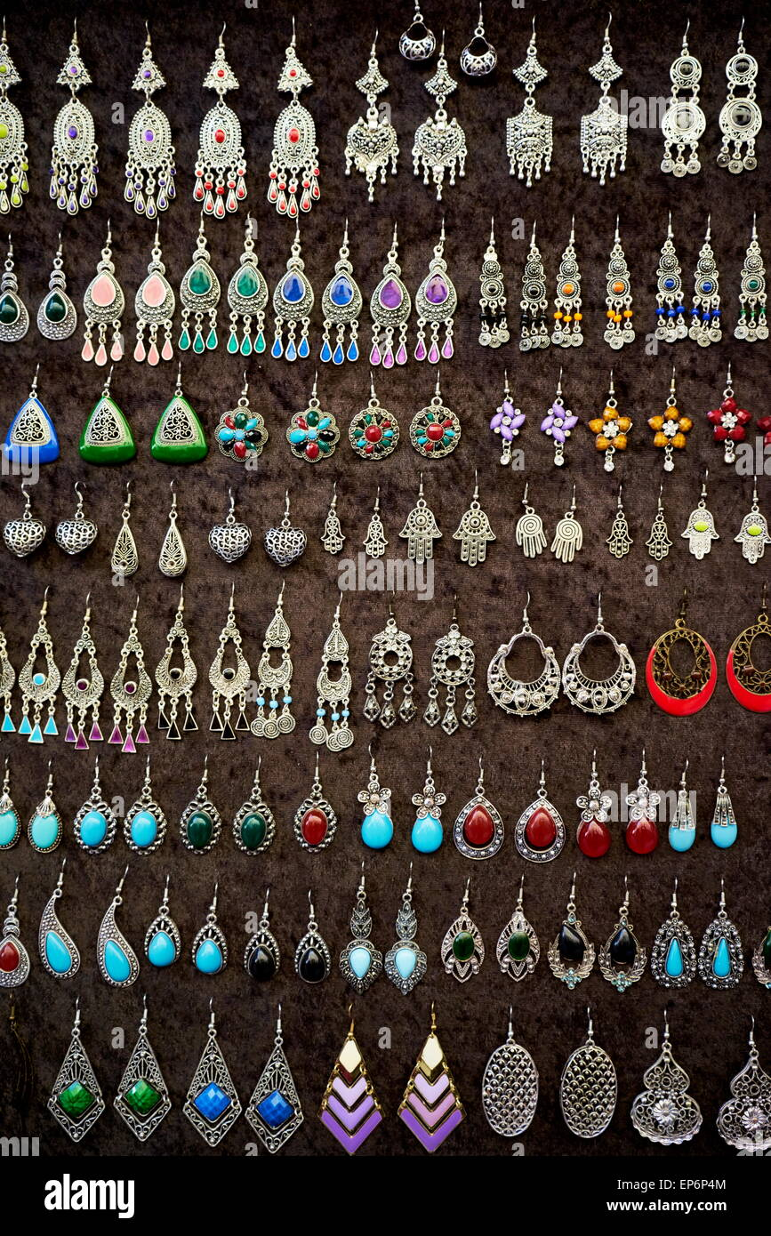 Silver and brass earrings and pendants in a souvenir shop. Morocco - Stock Image