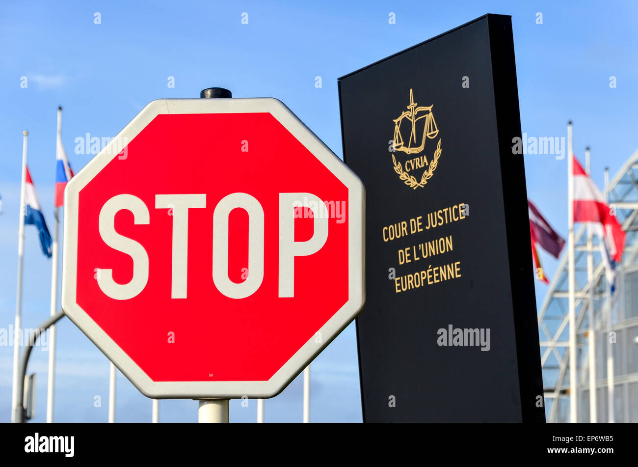 STOP sign in front of the entrance of the Court of Justice of the European Union, in European Quarter, Kirchberg, - Stock Image