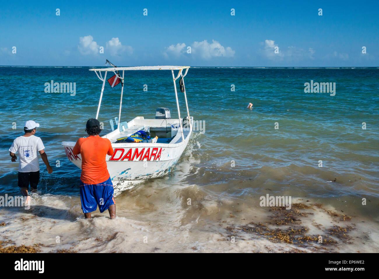 Fishing boat, Caribbean Sea coast in Puerto Morelos, Riviera Maya, Yucatan Peninsula, Quintana Roo state, Mexico - Stock Image