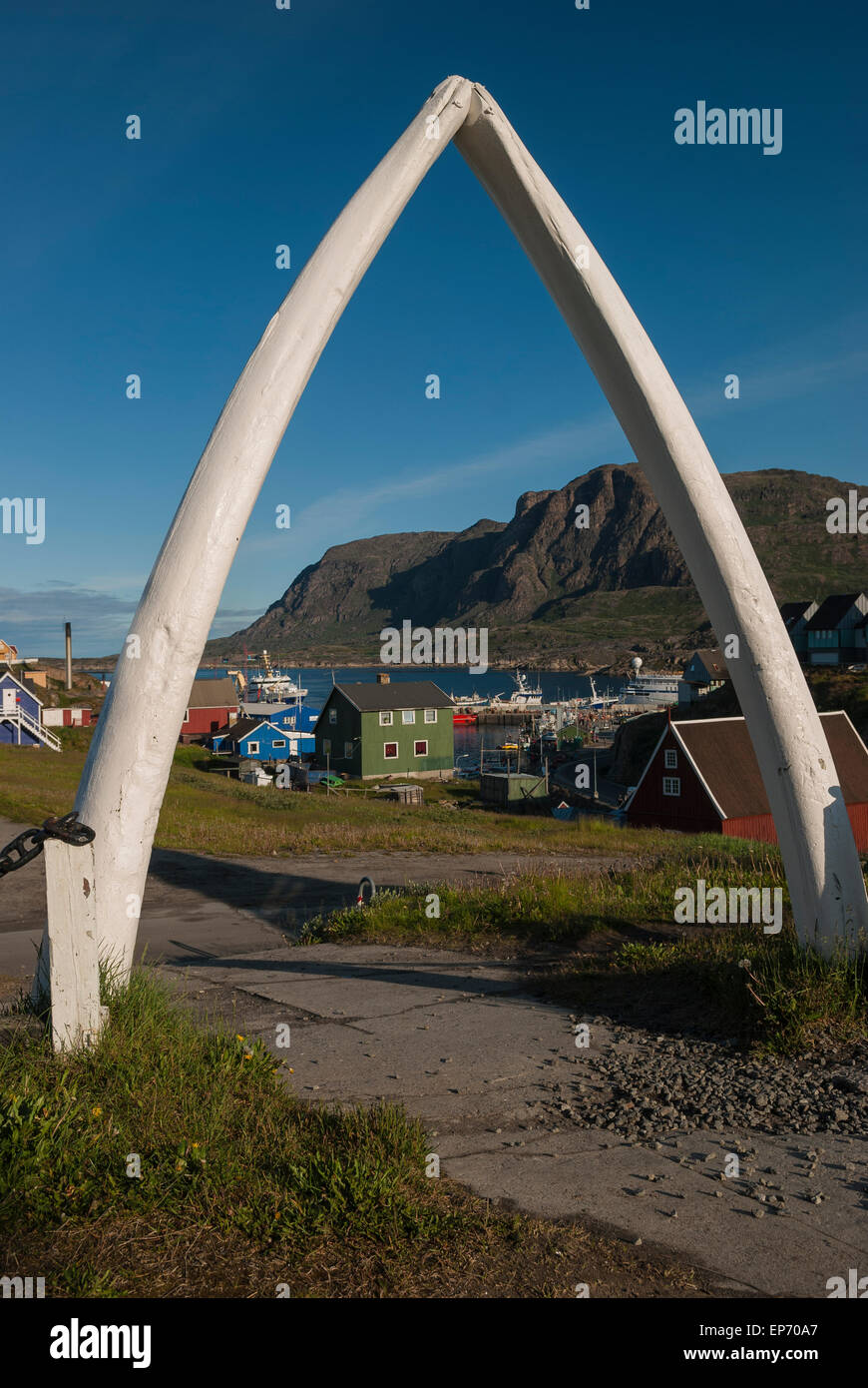 View of harbour through blue whale jaw bone gate at Sisimiut Museum in Greenland during summer season. Taken gorgeous Stock Photo