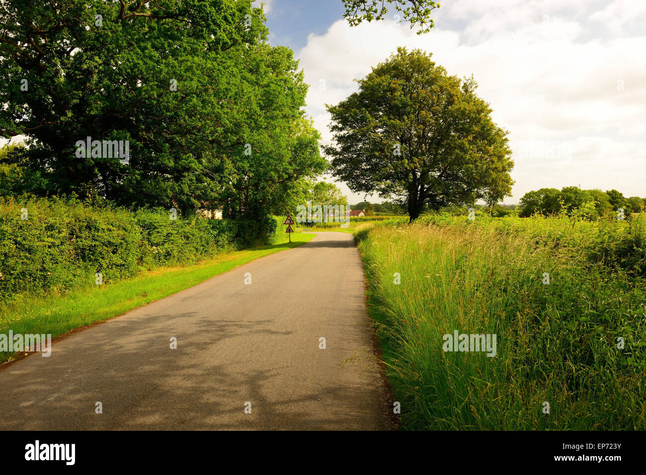 Country road with no traffic. - Stock Image