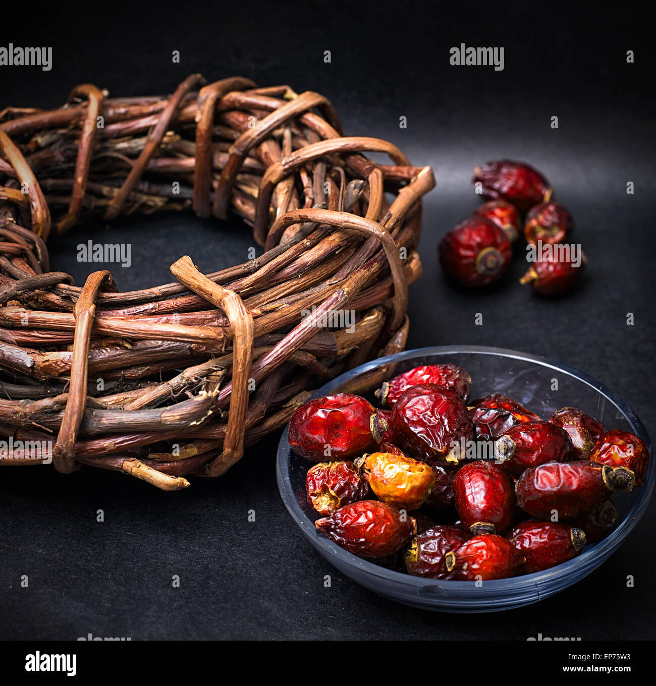 rose in white bowl on background licorice root bound in coil - Stock Image