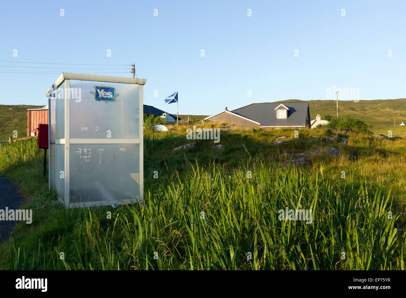 Isle Of Barra, Outer Hebrides, Yes Sticker On Bus Shelter with Scottish Saltire flag in background - Stock Image
