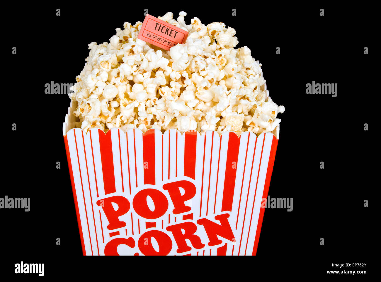 Bucket Of Fresh Popped Popcorn With Red Ticket On Black Background - Stock Image