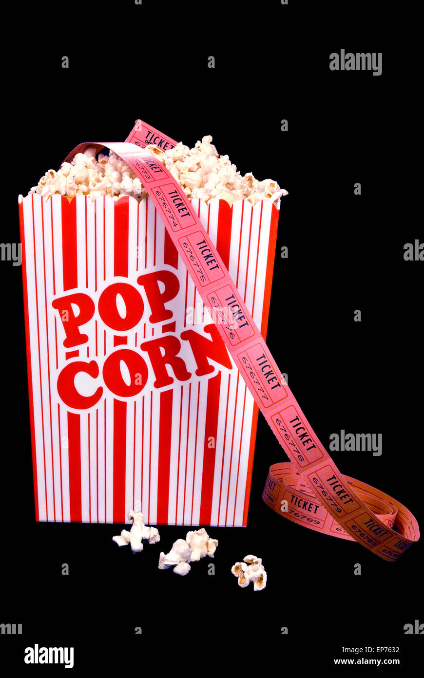 Bucket Of Popcorn With Roll Of Movie Tickets On Black Background - Stock Image