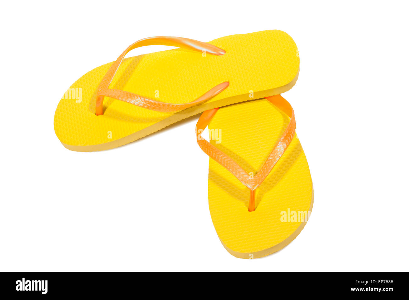 Brightly Colored Flip Flops For Summer Fun In The Sun.  On White Background Stock Photo