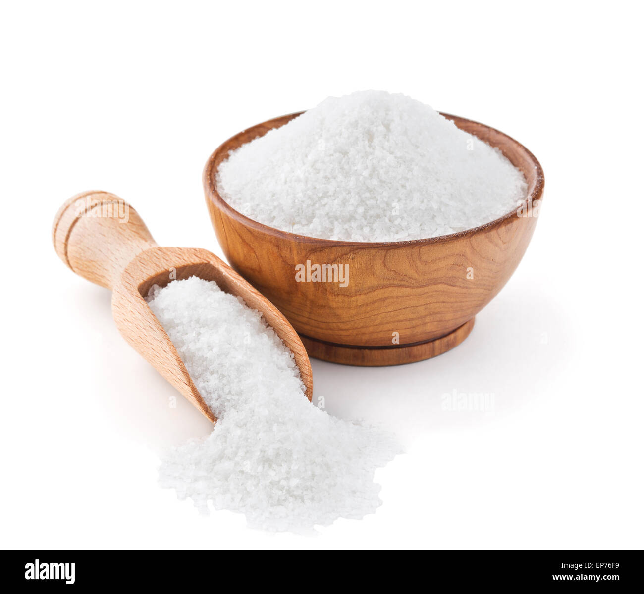 Regular table salt in a wooden bowl - Stock Image