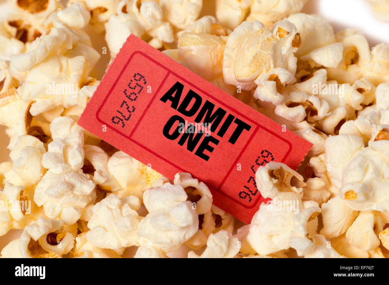 Popcorn Background With Red Admission Movie Ticket - Stock Image