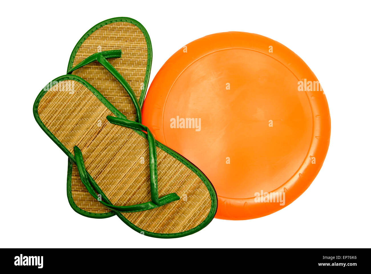 Fun In The Sun With Bright Orange Blank Frisbee And Colorful Green Sandals on white background.  Horizontal shot - Stock Image