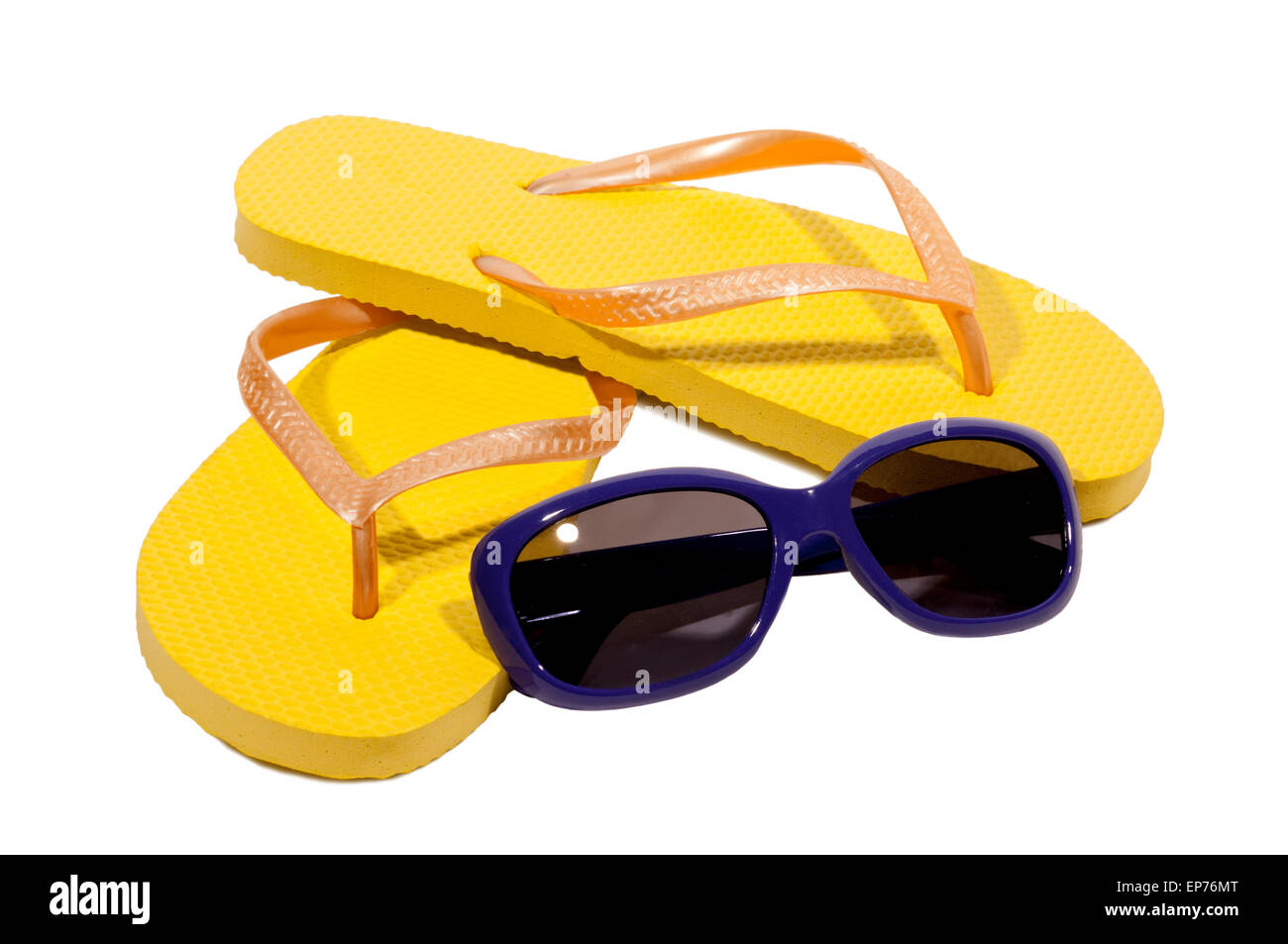 Summertime Fun With Flip Flops And Sunglasses on White Background. - Stock Image