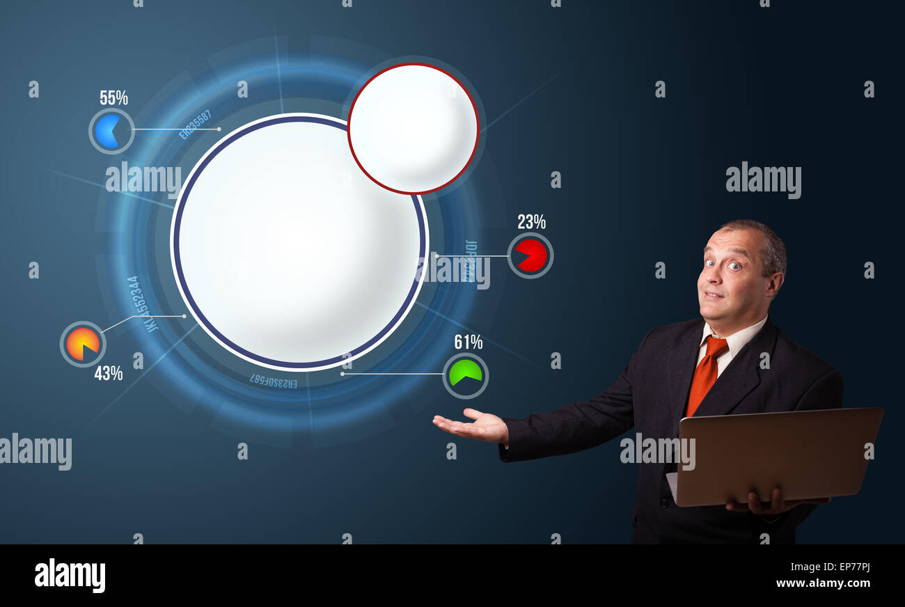 businessman holding a laptop and presenting abstract modern pie