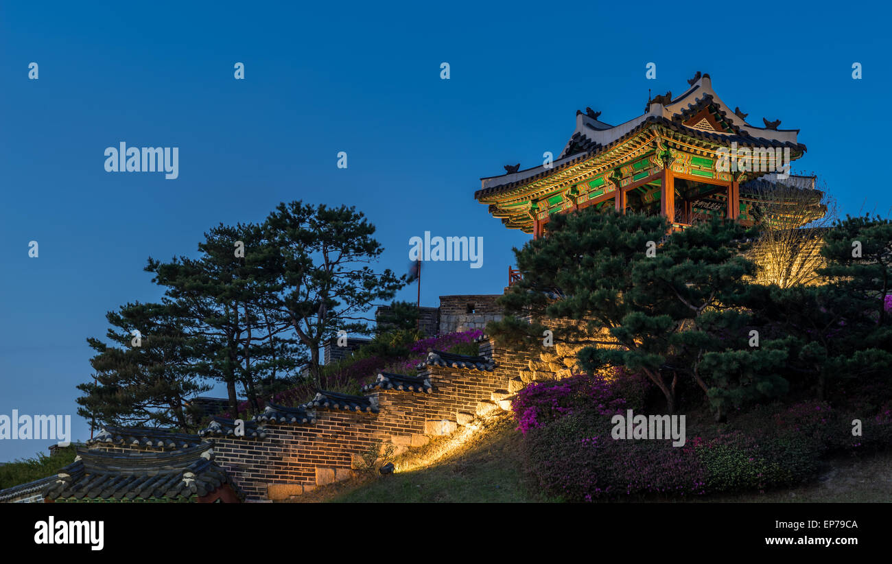 A watchtower at Hwaseong Fortress lit up at sunset in Suwon, South Korea. Stock Photo