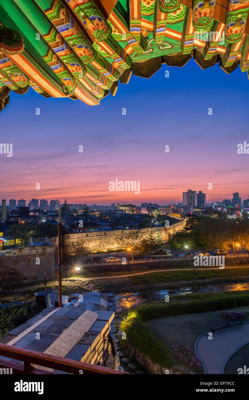 The sun sets behind Hwaseong Fortress in Suwon, South Korea. Stock Photo