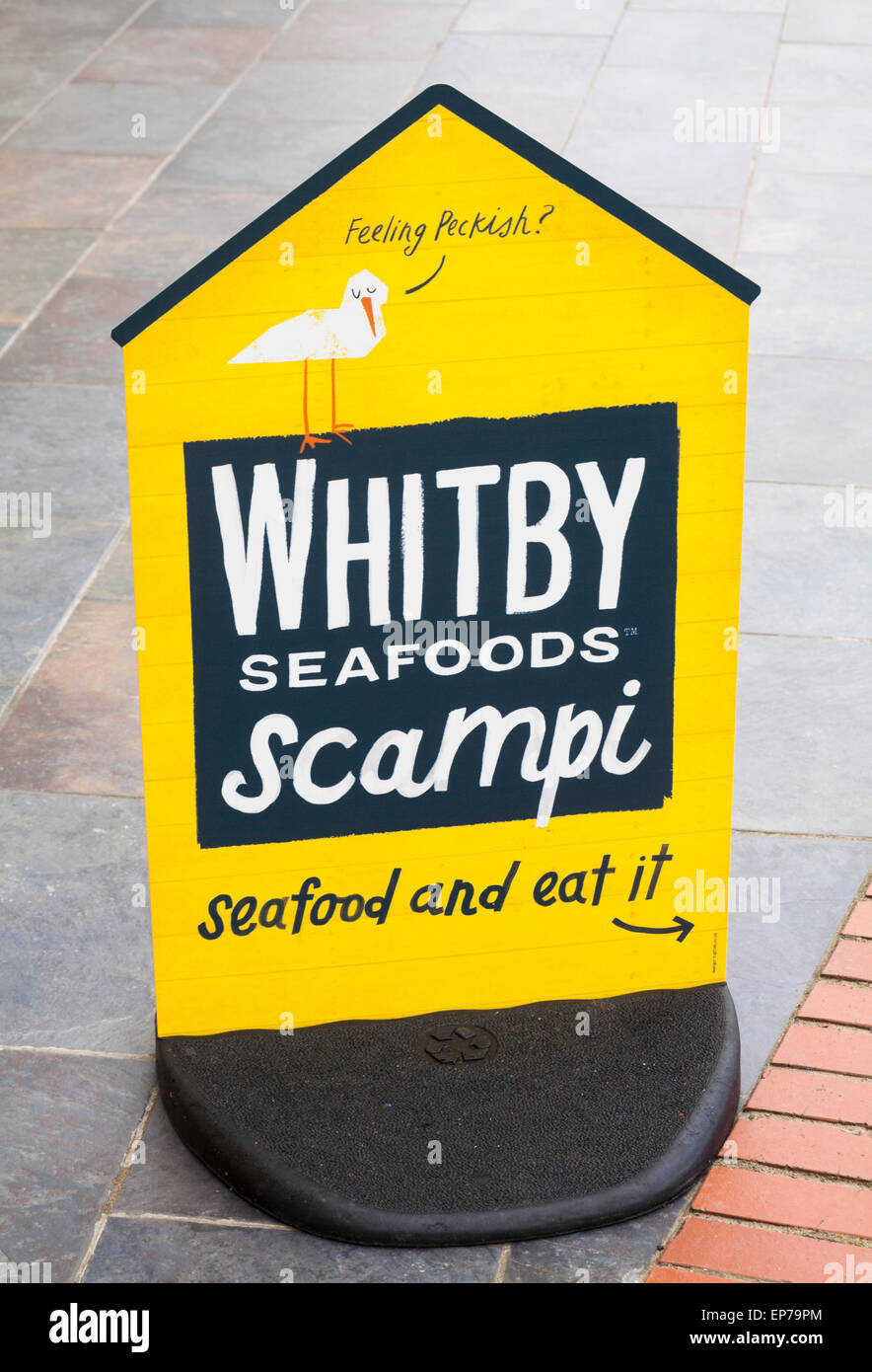 feeling peckish Whitby seafoods scampi seafood and eat it sign at The Parrog at the southern end of Newport Beach, - Stock Image