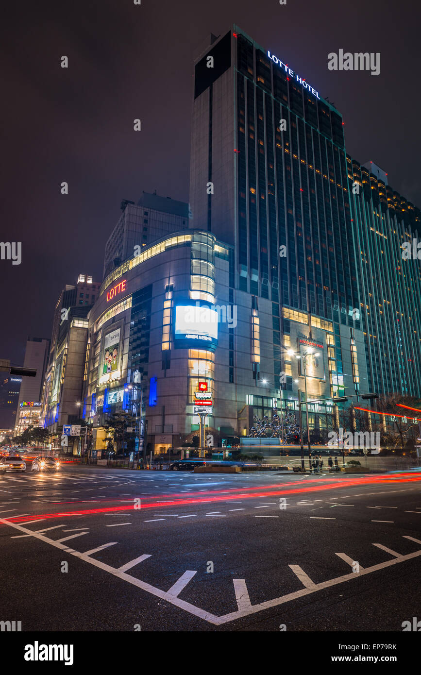 Lotte department store lit up at night in the Myeongdong district of Seoul, South Korea. - Stock Image