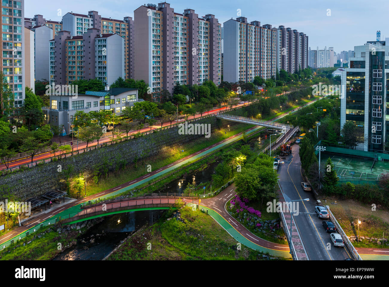 Urban scenic of a pathway and river cutting through the suburbs of Seoul, South Korea. - Stock Image