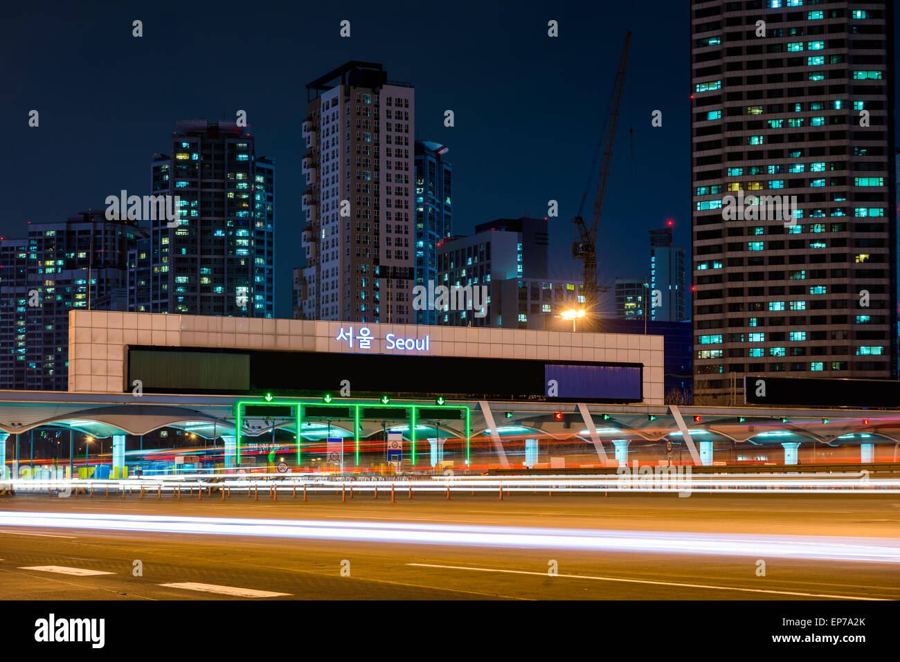Traffic blurs through a toll booth in Seoul, South Korea. - Stock Image