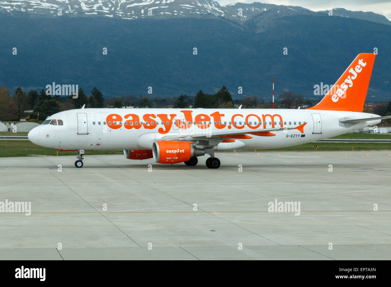 An EasyJet Airbus a319 taxying after landing at Geneva airport - Stock Image