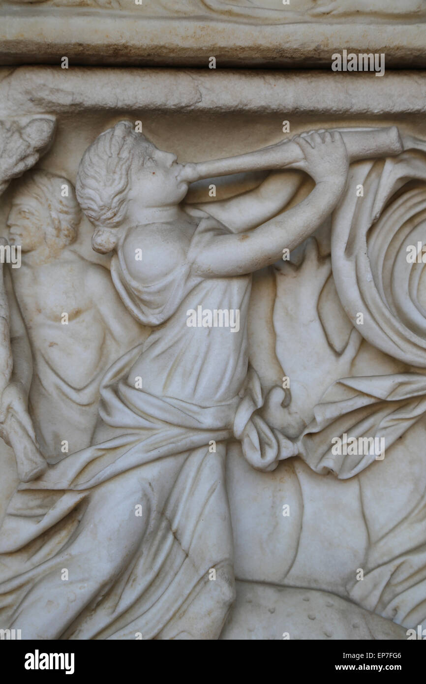 Sarcophagus with Dionysiac ceremonial procession. Maenad playing aulos. 2nd century AD. Rome. Italy. Stock Photo
