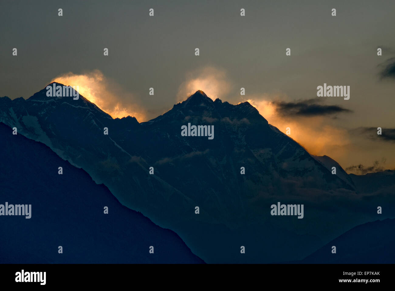 Sun setting behind Mount Everest seen from the Hotel Everest View, Solukhumbu, Nepal at 13000 feet high - Stock Image