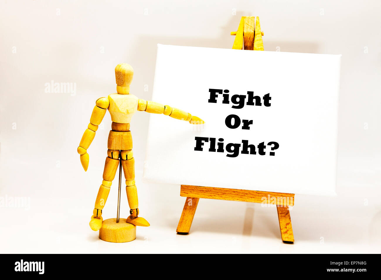 Wooden man with white board pointing at words 'Fight or Flight' response freeze PTSD stress physiological - Stock Image