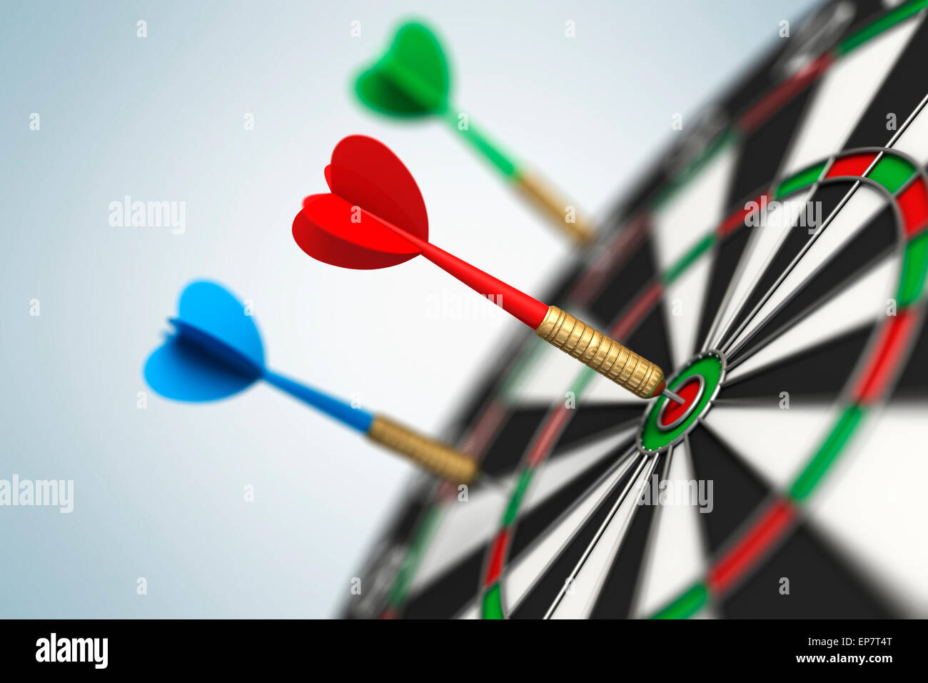Darts arrow in bull's-eye - Stock Image
