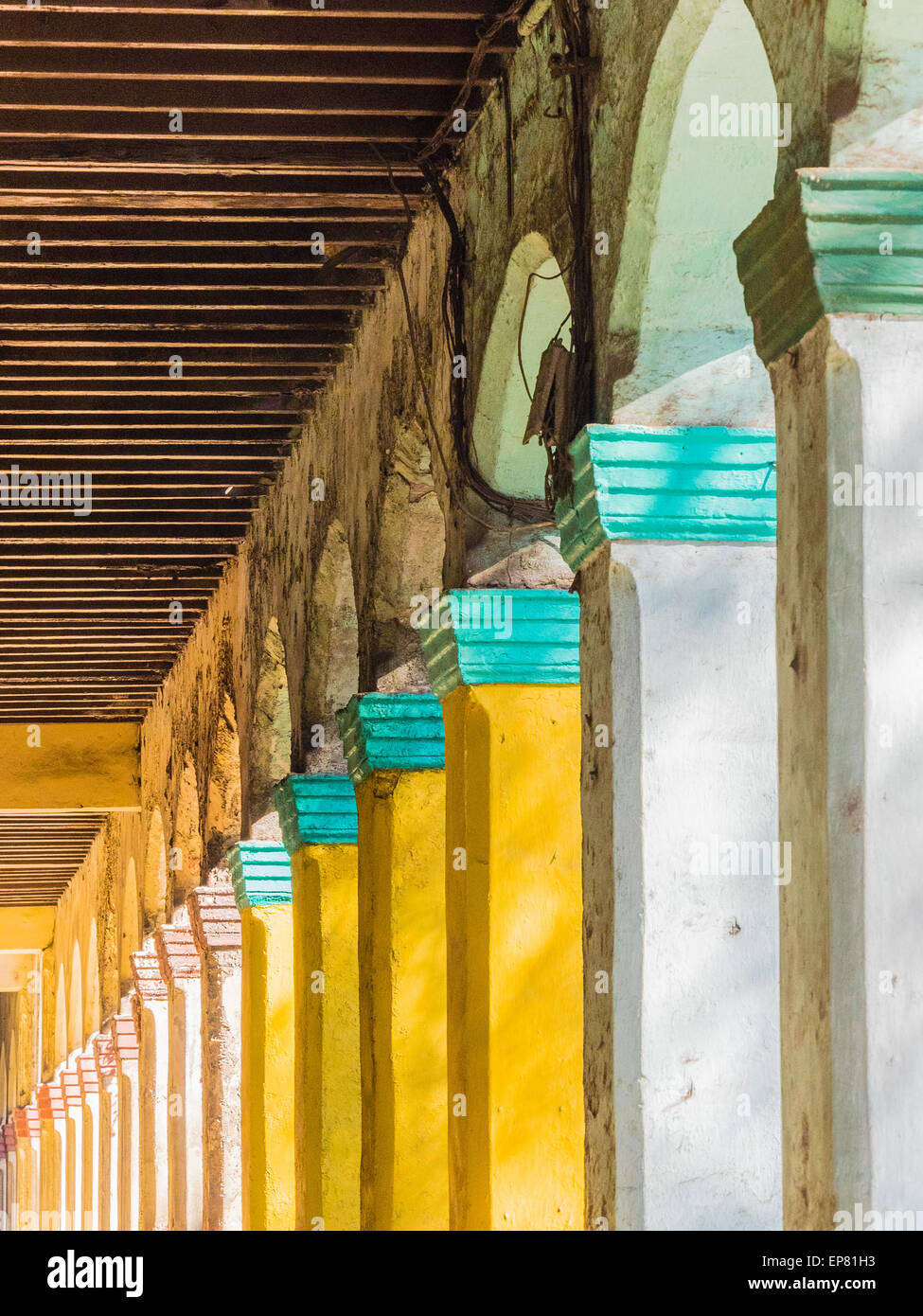 Repeated pattern of colorful capstones on columns in Havana Vieja, Cuba. - Stock Image